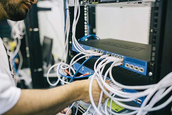 Person working on ethernet switch
